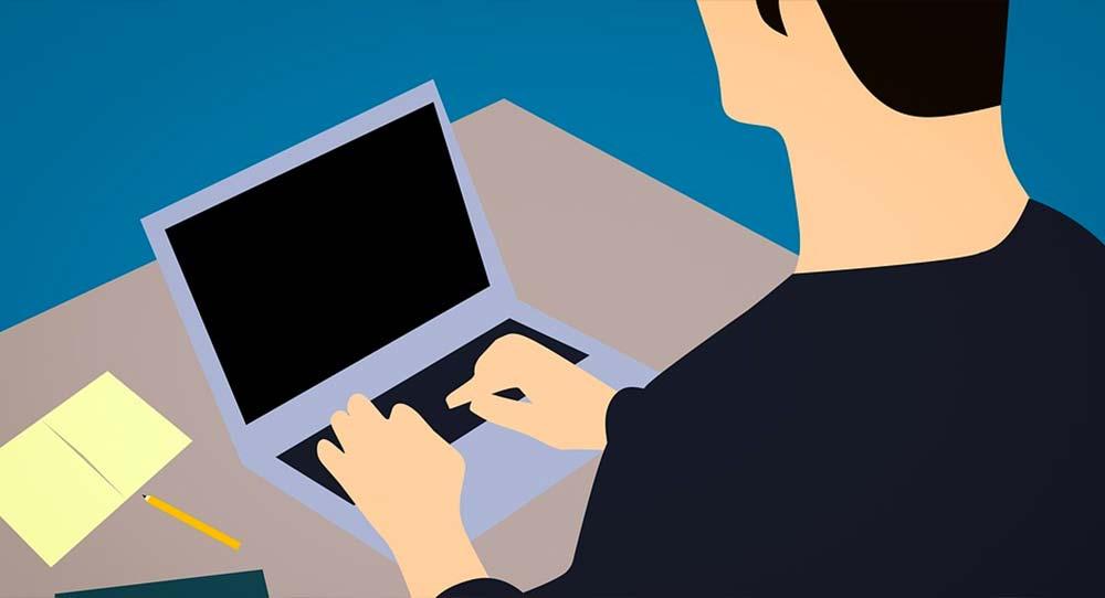 ilustración de un hombre en el PC mirando páginas para buscar empleo